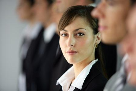 Here comes author rank - Young woman standing in line with coworkers